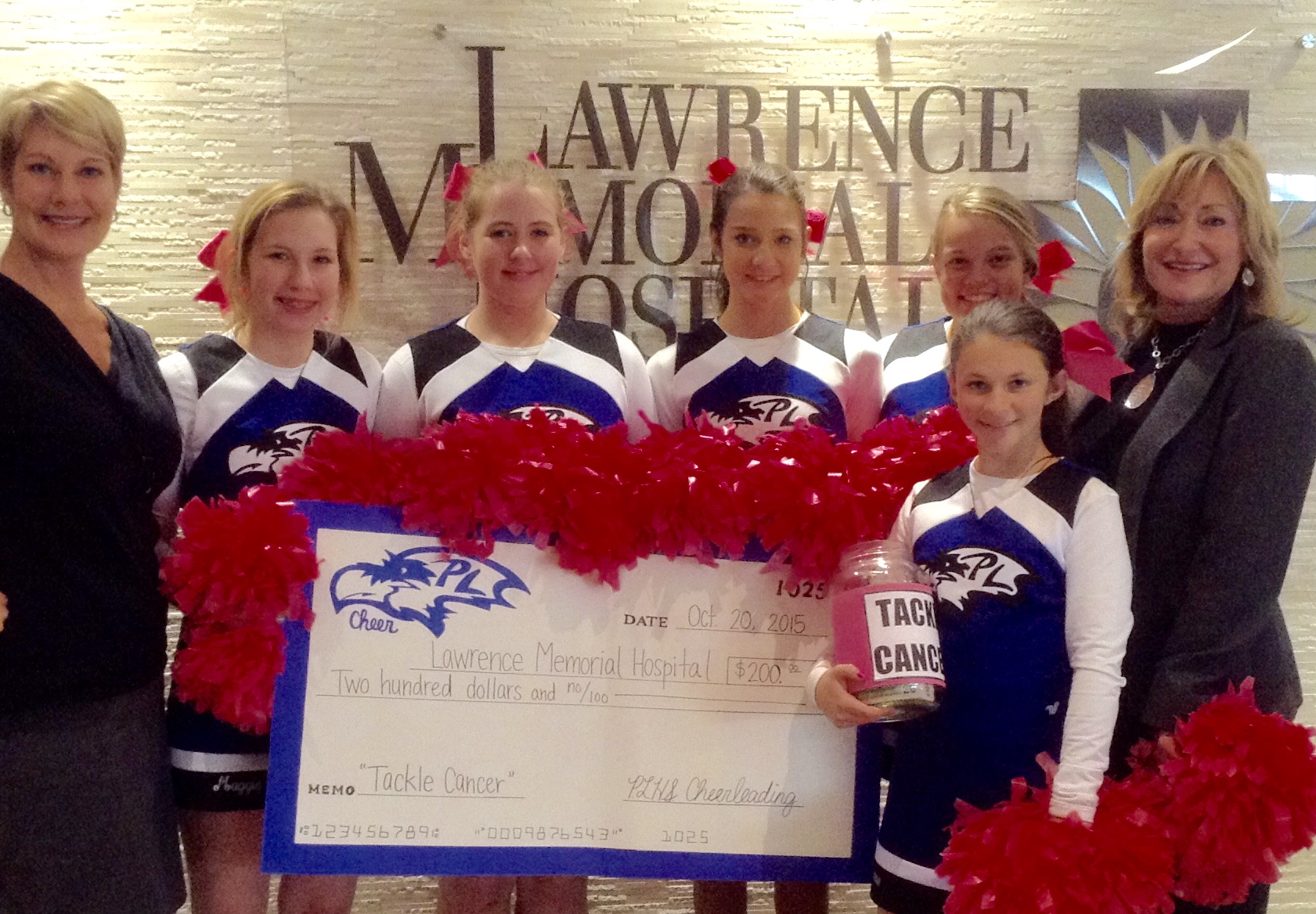 Members of the Perry-Lecompton High School cheerleading squad raised funds during October, breast cancer awareness month. The girls recently visited Lawrence Memorial Hospital to present the funds they raised. Pictured are, from left, Tiffany Hall, LMH Endowment Association annual giving manager, cheerleaders Maggie Schmidt, Madison Hite, Gabby Gonzalez, Darian Eddy and Breanna Lay, and Kathy Clausing-Willis, LMH vice president and chief development officer.